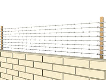 White brick wall topped with barbed wire  №3 Royalty Free Stock Images