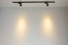 White brick wall with track light Stock Images