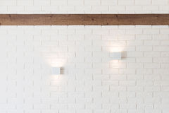 White brick wall with two lights Stock Image