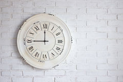 White brick wall with vintage clock royalty free stock photography