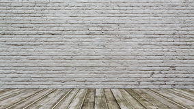 White brick wall and wood floor Stock Photography