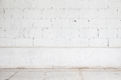 White brick wall and wood floor background Royalty Free Stock Photos