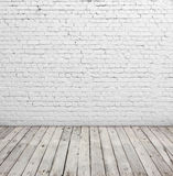 White brick wall and wood floor. Royalty Free Stock Photography