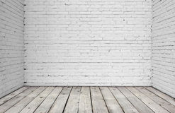 White brick wall and wood floor. Stock Photos