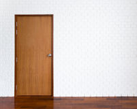 White brick wall with wooden door Stock Image