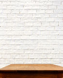White brick wall and wooden table Royalty Free Stock Photo