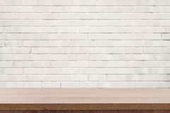 White brick wall and wooden table with copy space, display montage for product.  royalty free stock photo