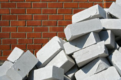 White bricks against red brick wall Royalty Free Stock Photo