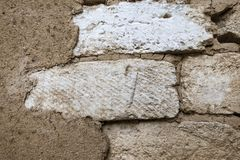 White bricks in a clay wall. Natural texture royalty free stock images