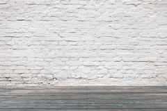 White bricks wall with old wooden floor Royalty Free Stock Image