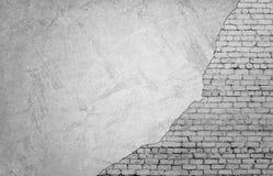 White brickwork underneath concrete wall Stock Photos