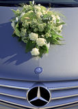 White bridal bouquet upon Mercedes car Royalty Free Stock Photos