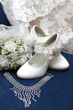 White bridal bouquet and shoes on blue velvet Stock Image