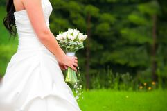 White bridal dress and flowers Royalty Free Stock Photos