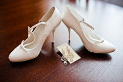 White bridal shoes with earrings Stock Photography