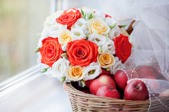 White Bridal Veil, apples in a basket and bridal bouquet Royalty Free Stock Photos