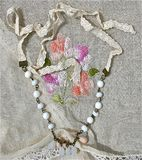 White Bridal Vintage Necklace. On lace cloth Royalty Free Stock Images