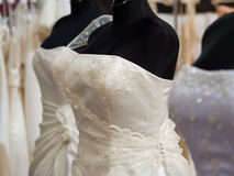 White bride costumes on shop mannequins Royalty Free Stock Image