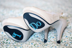 White Bride shoes with I DO text Stock Photo