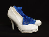 White bride shoes with sexy blue garter  Stock Image