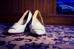 White brides. Shoes on carpet stock image