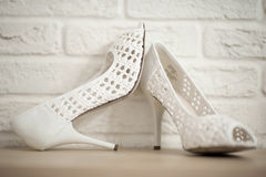White brides shoes. With holes stock photos