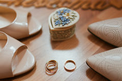 White brides shoes and rings Stock Photo