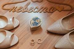 White brides shoes and rings Stock Images