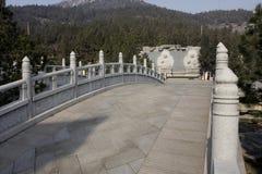 White bridge. In an Asian garden Stock Image
