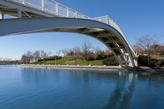 White bridge across the river. A canoeist passes under a bridge across in Madrid, Spain Stock Photo