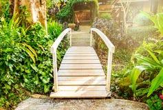 White bridge across walkway sylvan. In garden Royalty Free Stock Photos