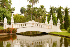 White bridge in asian garden. White bridge over pond in asian garden Royalty Free Stock Images