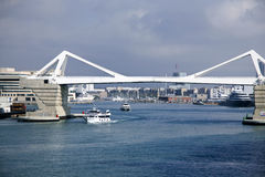 White Bridge, Barcelona, Spain. The iconic white bridge, joining the main part of the cily of Barcelona, Spain to the outer harbor and industrial ares. A white Royalty Free Stock Photography