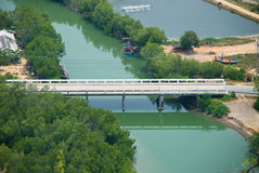 White bridge with emerald color canel Stock Photos