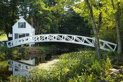White bridge. Little white house and wooden bridge at Somesville, Mount desert island, Maine, USA Royalty Free Stock Photography