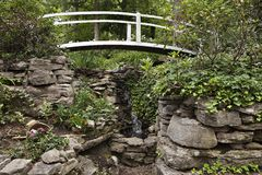 White bridge over waterfall Stock Images