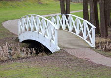 White bridge and path in park Stock Photo