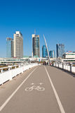 White bridge - pedestrian and bicycle bridge and modern building Stock Image