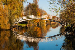 White bridge reflected in the water surface Royalty Free Stock Photo