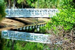 White bridge reflecting in water, Florida Royalty Free Stock Photos