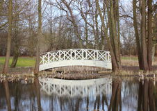 White bridge at small pond in park Stock Photos