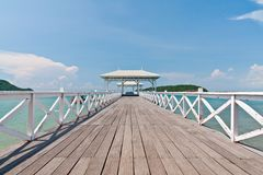 White bridge in to the sea with blue sky Royalty Free Stock Photo