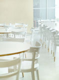 White and bright restaurant's interior Stock Image