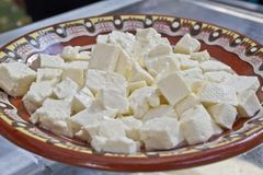 White brine cheese from cow, goat or sheep milk ready for eating . White brine bulgarian sirene ready for consummation. Traditiona Stock Photography