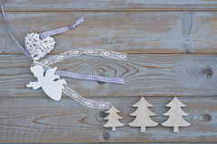 White brocante christmas decoration as christmas tree, angel and heart on a old grey wooden background with empty copy spac Stock Image