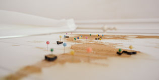White and Brown Archipelago Map With Colored Head Pins Royalty Free Stock Photos