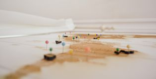 White and Brown Archipelago Map With Colored Head Pins Stock Photos