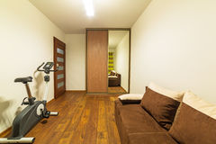 White and brown bedroom interior. White and brown bedroom with wooden floor Stock Image