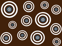 White, brown and blue targets on brown background. Funky white, brown and blue retro targets design on brown background Royalty Free Stock Photography