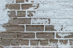White brown brick wall, paint, cracks, background, old, texture. White brown brick wall, paint cracks background. old texture graphics roughness shabby, vintage Royalty Free Stock Photography